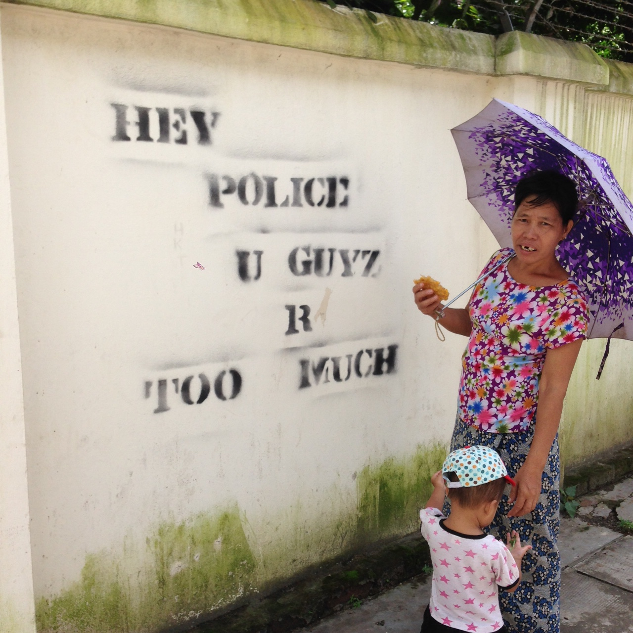 Woman and child in downtown Yangon