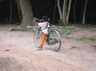 Young girl showing off her bicycle skills, Angkor, Cambodia, July 2012 © Cas Sutherland