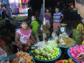 Fruitseller at a nighttime festival, Dawei, Myanmar, Jan 2016 © Cas Sutherland